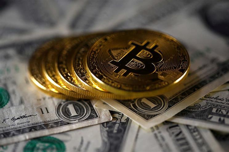 Bitcoin: moeda digital desafia o dinheiro tradicional